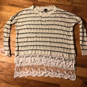 Striped tunic sweater with lace trim.